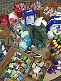 Photo Credit: SHASTA KEARNS MOORE - Donations of personal hygiene items flood a table at Estacada First Baptist Churchs Red Cross shelter.