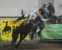 Photo Credit: LON AUSTIN/CENTRAL OREGONIAN - Tony Buckman scores 84 points Saturday night during the second go round of the NPRA Finals. Buckman finished second in the bareback average, which was enough to earn him first place in the year-end average.
