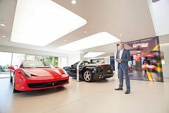 Photo Credit: TRIBUNE PHOTO: JOHN M. VINCENT - Brad Tonkin talks about his fathers love of Ferrari in the bright and spacious showroom of the familys new Wilsonville dealership.