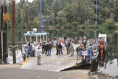 Photo Credit: RAY HUGHEY - Dignitaries and guests gather on the Canby Ferry as they await the start of the centennial celebration Wednesday afternoon.