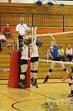 Photo Credit: JIM BESEDA/MOLALLA PIONEER - Molalla's Brie Riely (6) and Sabrina Vansmoorenburg (23) attempt to block a shot by Crook County's Jennifer McCallister during last week's Tri-Valley Conference match.