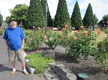 Photo Credit: BARBARA SHERMAN - HARD WORK PAYS OFF - Larry McCullough checks on the Highlands rose garden every morning, dead-heading the blossoms and caring for the plants as necessary.