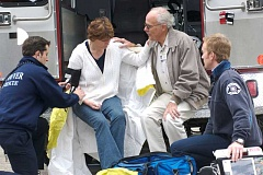 Photo Credit: SUBMITTED PHOTO: TRAUMA INTERVENTION PROGRAM - A Trauma Intervention Program volunteer comforts a woman while emergency responders do their job during a recent incident in Vancouver.