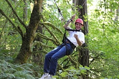 Photo Credit: SUBMITTED PHOTO: SEAN MINOGUE - Lake Oswego City Manager Scott Lazenby swings through the trees during Leadership Lake Oswegos two-day retreat in Newberg.