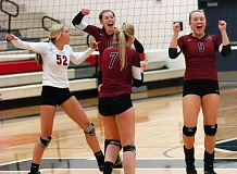 Photo Credit: DAN BROOD - SHERWOOD CELEBRATION -- Lady Bowmen players (from left) Maddy McSmith, Sarah Penner, Katie Munk and Maddy Giasson celebrate after scoring a point in Monday's match at Lake Oswego.