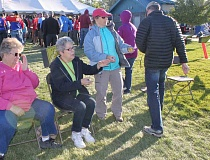 Photo Credit: HOLLY M. GILL - Local volunteers take tickets for meals from Cycle Oregon participants at Juniper Hills Park on Sept. 11. The 22 volunteer groups received a total of $26,575 for their efforts.