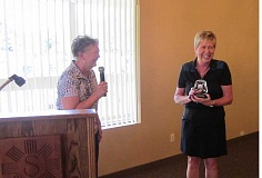 Photo Credit: BARBARA SHERMAN - BIG MOMENT - Summerfield Women's Golf Club President Jan Meek (left) announces that the 2014 club champion is Sandy Brewer, who won by one stroke in the four-game Championship Tournament in August.