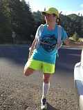 Photo Credit: CONTRIBUTED PHOTO - Jennifer Wolfsong, seen here finishing a 100-mile run she took on herself in 2012, plans to finish the Mountain Lakes 100 run this weekend to draw attention to, and raise money to help stop, ritualistic dolphin slaughters in Taiji, Japan.