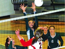Photo Credit: THE OUTLOOK: PARKER LEE - Reynolds Hanna Yamashita puts up a block in the middle of the net during Tuesday's home loss to Clackamas.