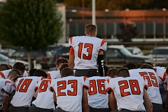 Photo Credit: JOHN WILLIAM HOWARD - Scappoose senior quarterback Joey Krupsky (13) talks with his teammates on the field before the game in Gladstone got underway. Krupsky continues to lead the Indians on offense with 14 touchdowns combined this season.