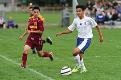 Photo Credit: HILLSBORO TRIBUNE PHOTO: CHASE ALLGOOD - Hilhi freshman forward Bryan Tapia dribbles the ball up field during last Thursday's game against Forest Grove.