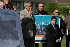 Photo Credit: TRIBUNE PHOTO JONATHAN HOUSE - Mayor Charlie Hales and Portland City Commissioner Steve Novick listen during a May press conference announcing a proposed Transportation User Fee for all Portland residences, businesses, governments and nonprofit organizations.