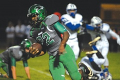 Photo Credit: THE OUTLOOK: DAVID BALL - Reynolds running back Jonas Ford gets around the corner for a big gain in the first half. He finished with three touchdowns, including the winning score on a 57-yard fumble return.