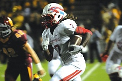 Photo Credit: THE OUTLOOK: DAVID BALL - Centennials Jesse Porter II takes a carry to the sideline during the second quarter of Fridays loss to Central Catholic.