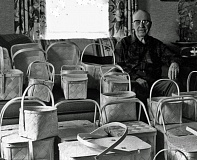 Photo Credit: COURTESY OF THE COLUMBIA COUNTY MUSEUM ASSOCIATION - E. J. Peterson at age 85, posing with some of his baskets in 1980, a year before his death. Peterson's baskets have become popular with collectors in the St. Helens area, and the Columbia County Museum Association is hoping to gather as many of them in one place as it can for its Oct. 15 open house.