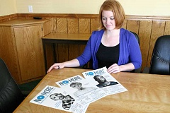 Photo Credit: JASON CHANEY - Maggie Campe, domestic violence project coordinator for Crook County Human Services, looks over posters from the national No More campaign. The campaign posters will  also be 'localized' with photos of Crook County community leaders.