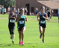 Photo Credit: JEFF WILSON/THE PIONEER - Almost 400 runners participated in the Madras Invitational Saturday at Kah-Nee-Ta Resort Golf Course. Hannah Orey of Culver battles with a pair of Summit runners at the finish line.