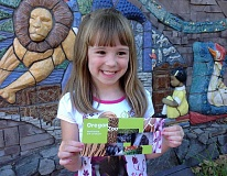 Photo Credit: SUBMITTED PHOTO - Emily Meisner proudly displays the family pass that she won in the grand prize drawing at the end of the Wilsonville Library's summer reading program. Emily and her family will get to visit the zoo for a full year.