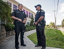 Photo Credit: SPOKESMAN PHOTO: JOSH KULLA - Wilsonville Police School Resource Officer Patrick Finn (left) and West Linn Police SRO Alistair Bunch (right) talk shop outside West Linn-Wilsonville School District headquarters on Stafford Road. Both Finn and Bunch started in their respective roles at the start of the current school year.