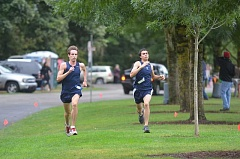 Photo Credit: SPOKESMAN PHOTO: COREY BUCHANAN - Josh Meyer (left) finished slighly ahead of Carlos Villagomez (right) at the inner-league meet last week.