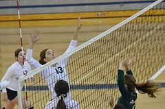 Photo Credit: COREY BUCHANAN - Sophie Bynum preparing to whack a volleyball against Rex Putnam.