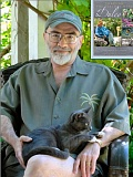 Photo Credit: LISA HILL - Ted Mahar, with a furry friend in his lap and, inset, the latest collection of his late wifes famous gardening columns, Through the Seasons With Dulcy. Ted still lives in their home in the Garthwick section at the south end of Sellwood.