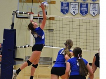 Photo Credit: TIMES PHOTO: MATT SINGLEDECKER - Valley Catholic sophomore Regan Dean tries to spike a ball over a Banks double team in the first set of the Valiants first Cowapa League loss of the season.