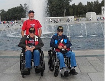 Photo Credit: SUBMITTED PHOTO - Henry Nelsen, 88, seated at left, and Herman Hansen, 87, both of Madras, were among 50 World War II veterans who participated in an Honor Flight to Washington, D.C., in September. Tom Brown, of Madras, who paid his own way on the trip, was the team leader for a group of nine veterans, including Nelsen and Hansen, which visited the Lincoln Memorial Reflecting Pool, above.