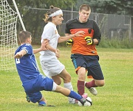 Photo Credit: SETH GORDON - C.S. Lewis Academy defender Christian Blair (center) and goalie Cole Evens converge to snuff out a threat during the Watchmen's 1-0 loss to North Clackamas Christian Sept. 25.