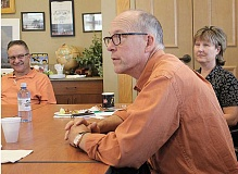 Photo Credit: HOLLY M. GILL - U.S. Rep. Greg Walden listens to local business leaders during a meeting last Friday, with County Commissioner John Hatfield and Janet Brown, county economic manager for EDCO, in the background.