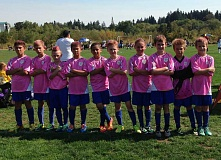 Photo Credit: SUBMITTED PHOTO: BECKY EMMETT - The U10 Gold Team Xeneize is part of the Oswego Juniors boys program's effort to raise dollars for the Susan G. Komen Foundation.