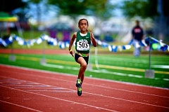 Photo Credit: SUBMITTED PHOTO: RALPH GREENE - Sevyn Watson flies to the finish line June 1 at the Portland Track Festival in Hillsboro. She won the 2014 Oregon USA Track & Field Female Younger Girl (12 and under) Track Athlete of the Year Award.