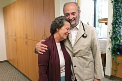 Photo Credit: TIMES PHOTO: JAIME VALDEZ - Husband and wife Darlene and Franklin Weingarten hug at Meridian Family Care, a clinic they've run for 35 years.