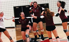 Photo Credit: DAN BROOD - BOWMEN YELL -- The Sherwood High School volleyball team, including, from left, Maddy McSmith, Sarah Penner, Taylor Hubbard, Kendall Howes and Mallory Shields celebrate after scoring a point in Tuesday's match at Tualatin. The Lady Bowmen scored a 3-1 victory.