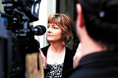 Photo Credit: FILE PHOTO - Amy Painter, widow of the late Rainier Police Chief, Ralph Painter, talks to news media in March 2013 after a court hearing in the murder trial for Daniel Butts. Butts is accused of shooting and killing Ralph Painter in 2011.