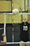 Photo Credit: MATTHEW SHERMAN - West Linn freshman Isabella Bean elevates for a block during Tuesday's match against Newberg.