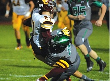 Photo Credit: THE OUTLOOK: DAVID BALL - Reynolds cornerback Zach Osborne brings a Central ball carrier to the ground during Fridays 52-2 loss.