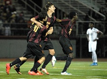 Photo Credit: PAMPLIN MEDIA GROUP: DAVID BALL - Central Catholics Brennan Weber (middle) celebrates with teammates Jesse Goncalves (left) and Peter del Mar after scoring off a free kick from 25 yards in the Rams 1-0 victory over David Douglas last week.
