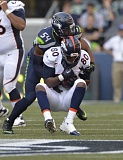 Photo Credit: COURTESY OF MICHAEL WORKMAN - Denver Broncos tight end Julius Thomas, from Portland State, catches a pass in front of Seattle linebacker Bobby Wagner, has become a primary target for QB Peyton Manning -- on record-setting throws, too.