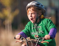 Photo Credit: SPOKESMAN PHOTO: JOSH KULLA - Excitement was the word of the day at Lowrie Oct. 3, when students headed out into a beautiful fall day to ride their wheels around the school building.