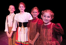 Photo Credit: SPOKESMAN PHOTO: JOSH KULLA - From left, Andrew Worth, Sara Stewart, Malia Case and Erin Lauthner play the youngest Von Trapp children in the WHS production of 'The Sound of Music.'