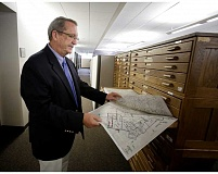 Photo Credit: JON HOUSE - Clackamas County Tax Assessor Bob Vroman looks over old, physical copies of residential parcel maps.
