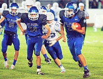 Photo Credit: PHIL HAWKINS - Rushing forward - Tyler Smith turns upfield during St. Pauls 34-20 win over Central Linn Friday at the rodeo grounds. Smith rushed for 188 yards and one touchdown.