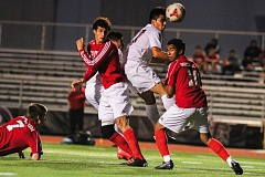 Photo Credit: NEWS-TIMES PHOTO: AMANDA MILES - Forest Grove's Javier Sanchez-Villarreal goes airborne for a header between two South Salem defenders during last Thursday's soccer match.