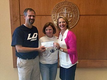 Photo Credit: SUBMITTED PHOTO - During a recent check presentation to Lake Oswego High School, Daimler Director of Executive Management Development Eileen Frack, right, pauses for a photo with LOHS Principal Cindy Schubert and LOHS Science Department Chair Steve Huss.