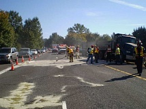 Photo Credit: SUBMITTED PHOTO - ODOT and fire personnel worked to clean up a diesel spill after a multi-vehicle crash near West Linn Thursday morning.