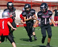 Photo Credit: SUBMITTED PHOTO - The Tualatin Black third/fourth-grade team looks to get the ball up field during its win over Oregon City.