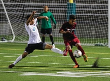 Photo Credit: HILLSBORO TRIBUNE PHOTO: CHASE ALLGOOD - Century's Eric Guzman lunges to block a clearance off the foot of Glencoe's Efren Placito during Monday's Metro League boys soccer match. Glencoe picked up a hard-fought 1-0 victory.