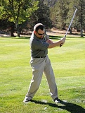Photo Credit: LON AUSTIN/CENTRAL OREGONIAN - Jason Chaney swings and misses during Saturday's golf tournament.