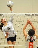 Photo Credit: LON AUSTIN/CENTRAL OREGONIAN - Jennifer McCallister goes up for a kill in the Cowgirls' victory over the Molalla Indians on Monday.